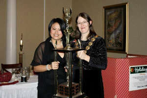 Chapter President Elaine Magalona receiving the 100 Percent Efficient Award trophy from NYS State President Stephanie Kingsley.