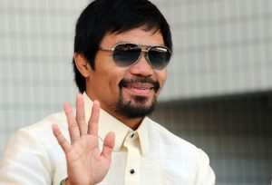 "Philippines' eight-time world boxing champion Manny Pacquiao reacts to audience as he attends the opening ceremony for the ""Philippine Festa"" in Tokyo on September19, 2015. Pacquiao said he would open a gym in Tokyo. AFP PHOTO / Yoshikazu TSUNO (Photo credit should read YOSHIKAZU TSUNO/AFP/Getty Images)"